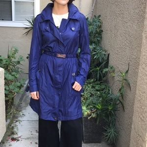 Dark blue Burberry trench coat with carrier bag